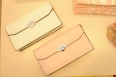 Structured flip clutches in several feminine shades. Clutches $53.90